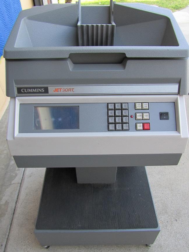 cummins coin machine